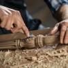 Carpenter using chisel