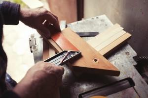 Woodworker taking measurements